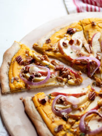 Vegan Butternut Squash Pizza with Apples & Pecans recipe. Who knew? Butternut squash makes a silky-smooth and full-flavored pizza sauce - the perfectly creamy base for this fall-inspired pie.