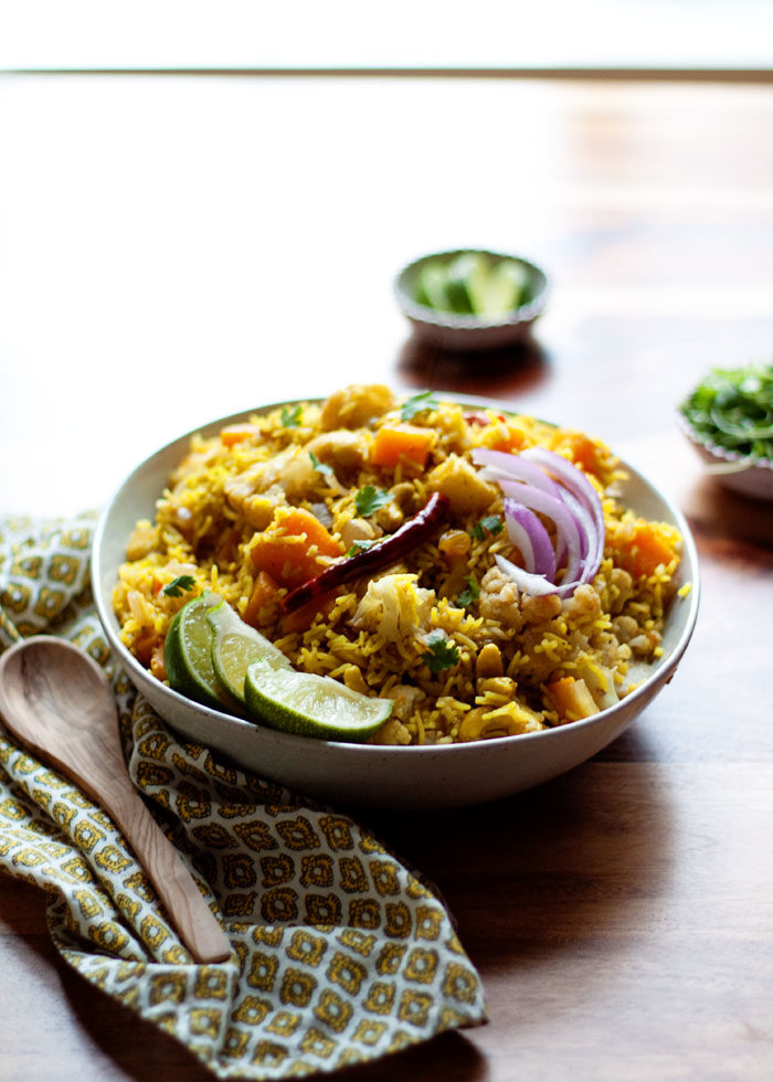 Biryani-Inspired Indian Vegetable Rice - This Indian-influenced, aromatic rice dish boasts butternut squash, cauliflower, cashews, golden raisins, and autumn-perfect flavors. And it's one of my favorite recipes for fall! Vegan and gluten-free.