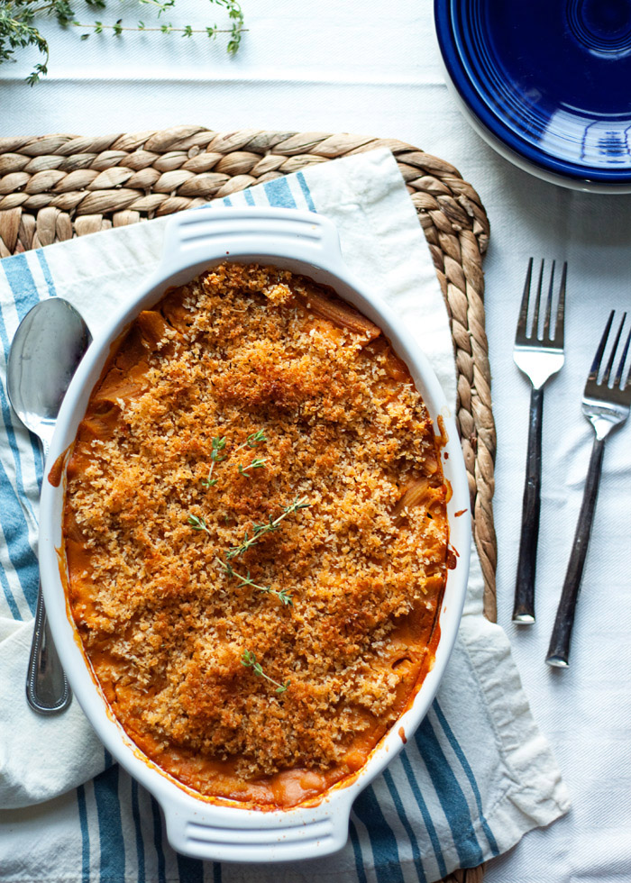 Creamy Butternut Pasta Bake recipe - Whole wheat penne drenched in velvety butternut squash sauce, topped with herbed panko breadcrumbs, and then baked until bubbly and golden-brown. Vegan recipe with gluten-free option.