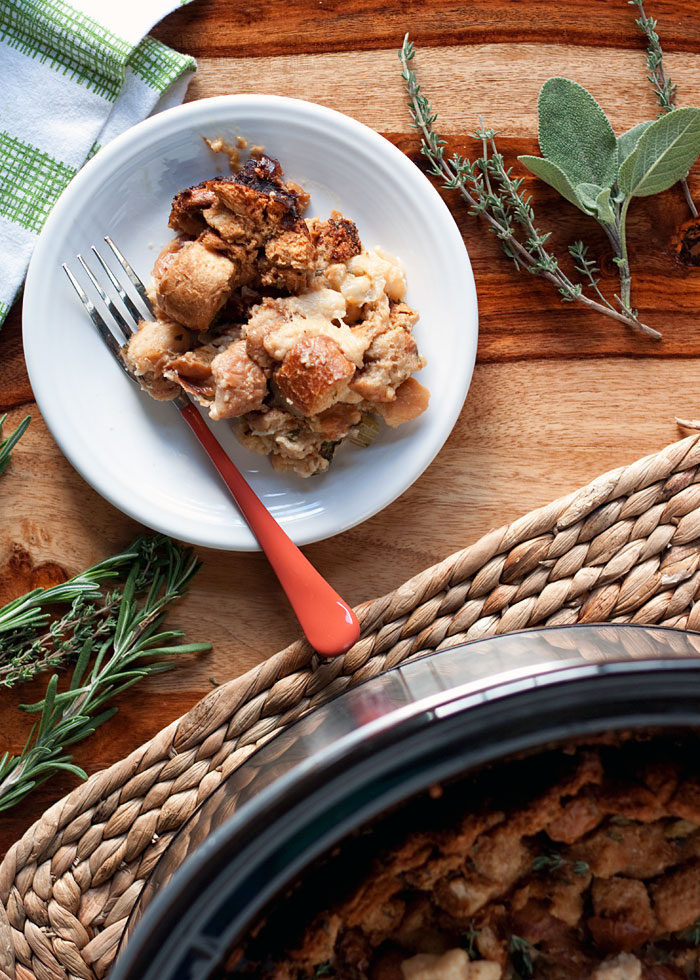 Slow Cooker Sourdough Herb Stuffing recipe - This simple Crock Pot stuffing recipe stays moist in the middle and gets golden-crisp around the edges. Holiday perfection - plus, it's vegetarian and dairy-free!