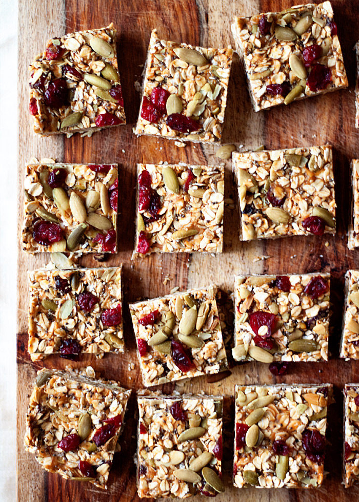 No-Bake Peanut Butter Granola Bars with Dried Cranberries & Pepitas - These refrigerator granola bars take mere minutes to assemble. Our favorite homemade grab-and-go snack! Vegan, GF.