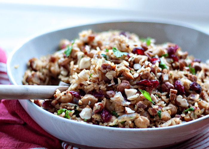 Nutty Chickpea Pilaf recipe - A hearty pilaf with a satisfying nutty crunch and, thanks to a handful of dried cranberries, a touch of contrasting sweetness. A plethora of chickpeas elevates what's typically a side to entree status. My favorite dinner lately! Vegan, gluten-free.