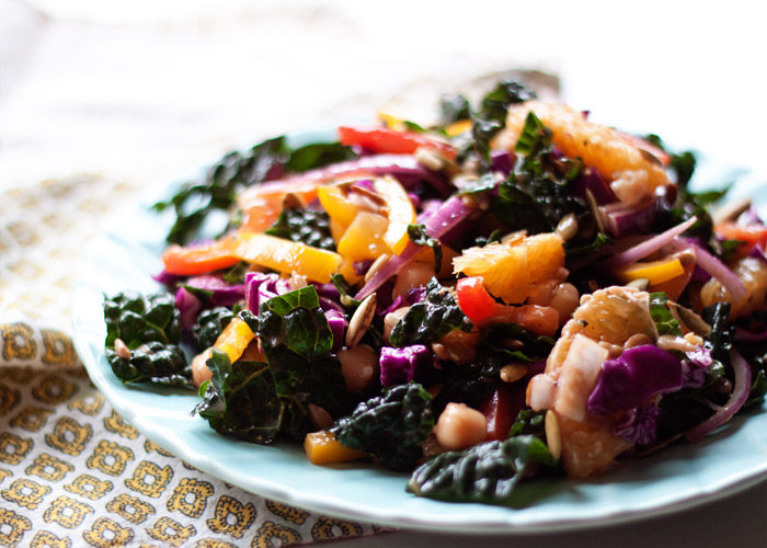 Hippie Chopped Salad recipe - Nearly every color of the rainbow is represented in this salad with kale, crunchy bell peppers, juicy oranges, and more. Chickpeas, sunflower seeds, and pepitas add protein and crunch! All that and oil-free too.