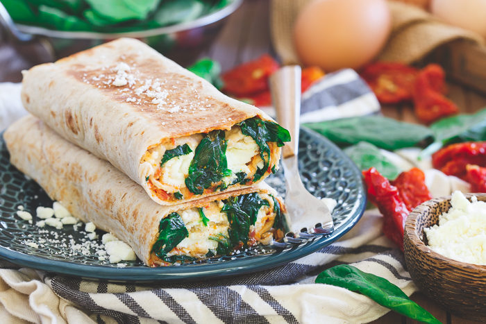 Spinach & Feta Breakfast Wrap recipe - The famous Starbucks breakfast wrap can easily be made at home. With egg whites, a whole grain lavash wrap, a simple homemade sun-dried tomato spread, spinach, and feta, it's actually way easier than you might think.