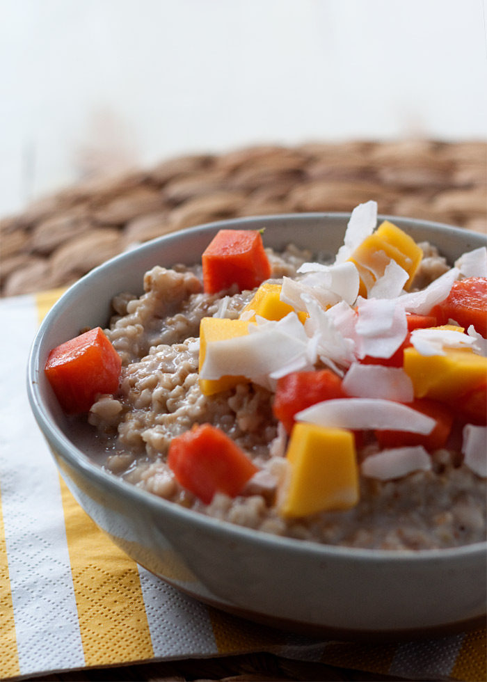 Uber-creamy and utterly flavorful oats topped generously with mango, papaya, and coconut. Like a taste of the tropics, any time of year! Vegan and gluten-free.