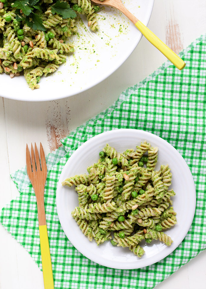 Pea Pesto Pasta Salad - This easy vegan salad boasts a creamy pea pesto with parsley, mint, pine nuts, and lemon. Perfect for make-ahead lunches and potlucks. Gluten-free option.