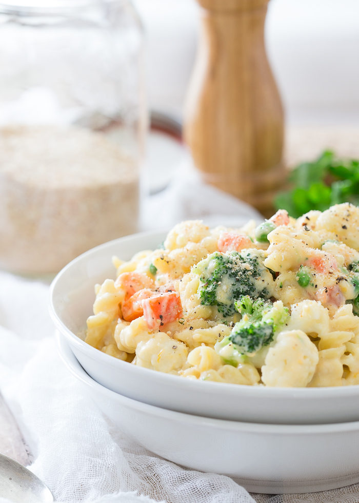 Veggie Lovers' Stovetop Mac and Cheese recipe - Love this creamy, cheesy, veggie-packed mac and cheese recipe! Broccoli, cauliflower, peas, and carrots join up with whole-wheat pasta plus three cheeses for comfort food with a veg-heavy twist.