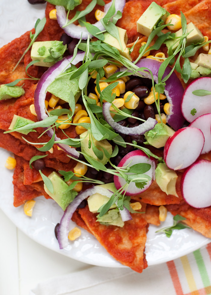 Spicy Chipotle Chilaquiles (3 Ways!) - A bit like a cross between enchiladas and nachos, this version of the easy Mexican dish features healthier baked (not fried) corn tortillas bathed in a spicy chipotle-tomato sauce. Then top individual portions to your heart's delight - easily customized for vegans, vegetarians, and omnivores!