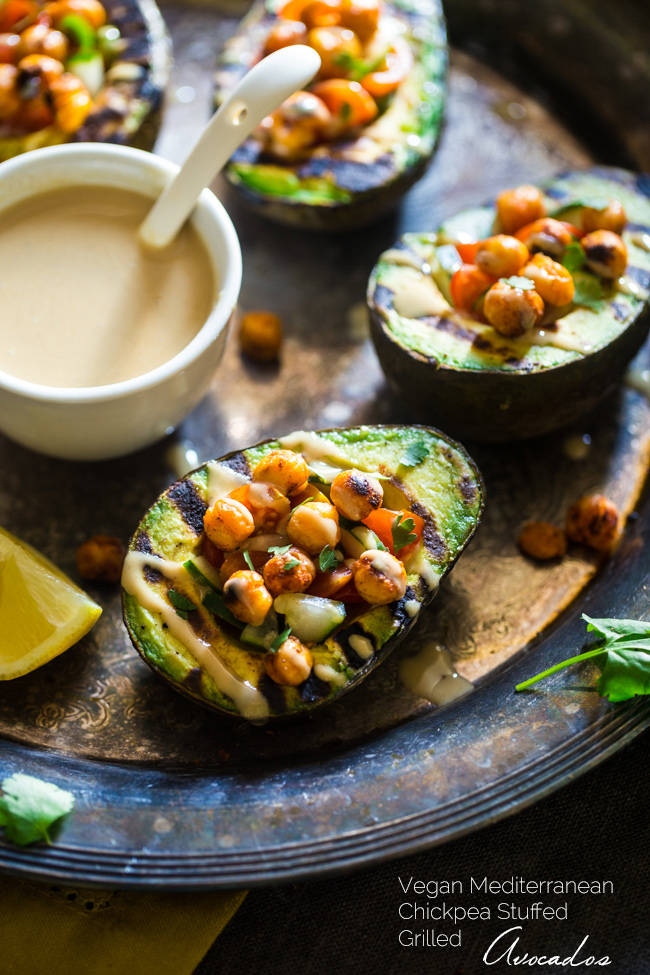 15 Vegan Dinners for the Grill - like these Mediterranean Grilled Avocadoes Stuffed with Chickpeas & Tahini from @foodfaithfit