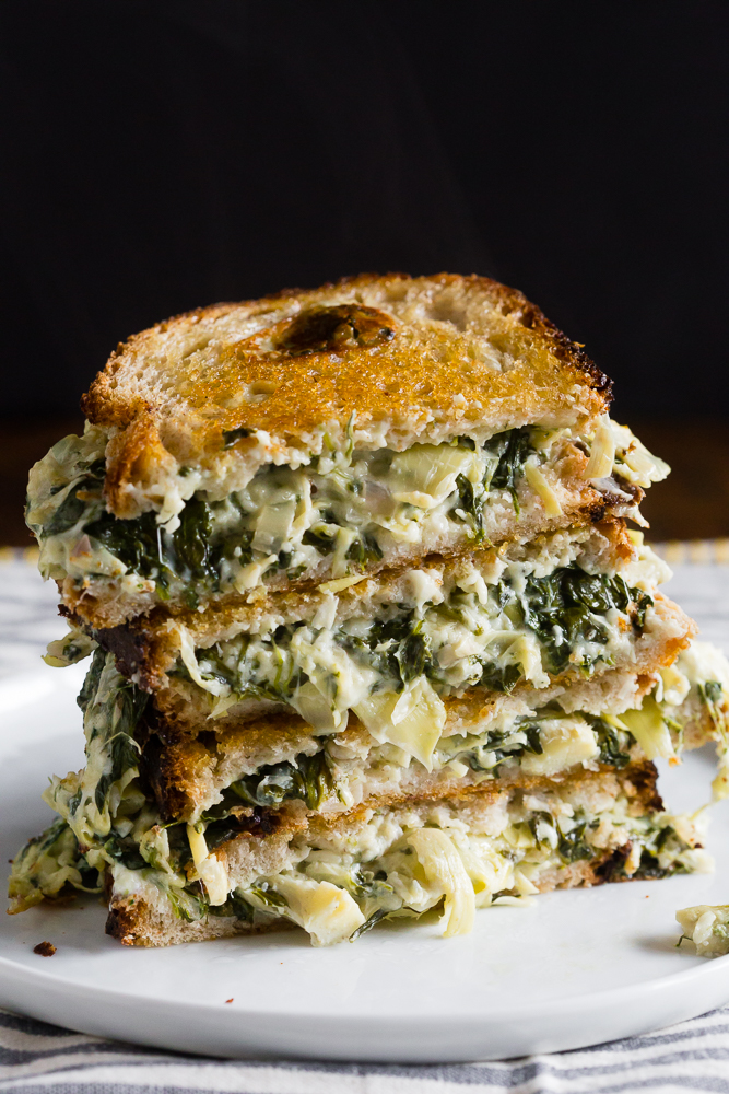 Spinach & Artichoke Grilled Cheese recipe - Inspired by the classic dip, with spinach, artichoke hearts, and three cheeses. The ultimate adult grilled cheese!