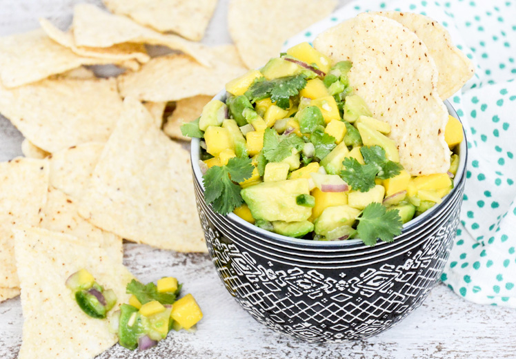 41 Fantastic Fruit Salsa Recipes - like this Tequila-Spiked Mango & Avocado Salsa from @FloatingKitch