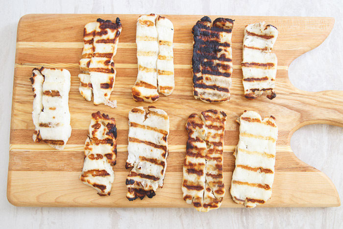 Slices of grilled halloumi on a cutting board