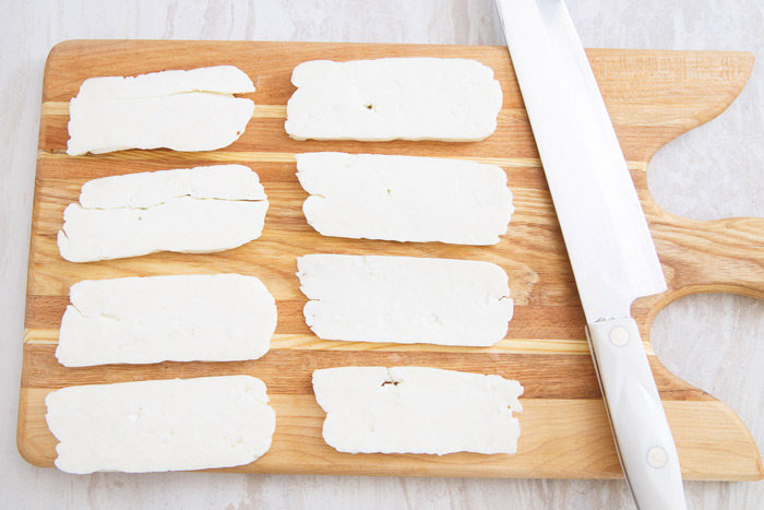 Slices of halloumi cheese ready to grill