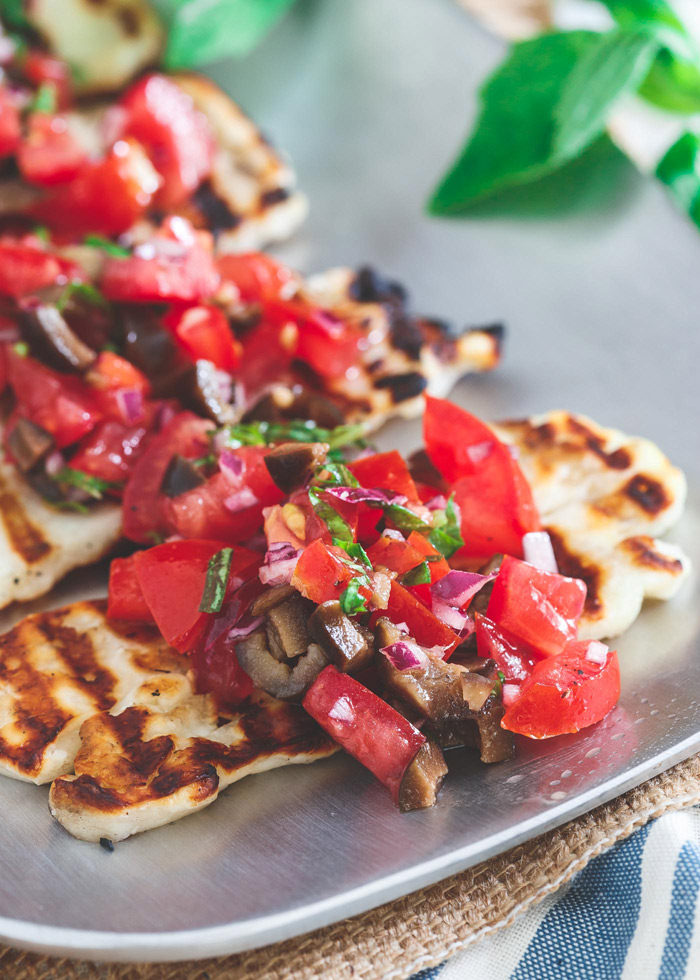 Grilled Halloumi Bruschetta recipe - Grilled halloumi makes an incredible base for bruschetta - no bread needed! If you prefer lower-carb fare, this is THE appetizer for you.