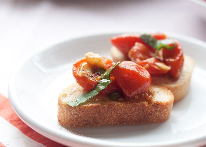 Slow-Roasted Tomato & Garlic Bruschetta recipe - Slow-roasting cherry tomatoes brings out intense flavor! Mix with roasted garlic and fresh basil then spoon over golden-brown garlicky toasts - delicious. Vegan.