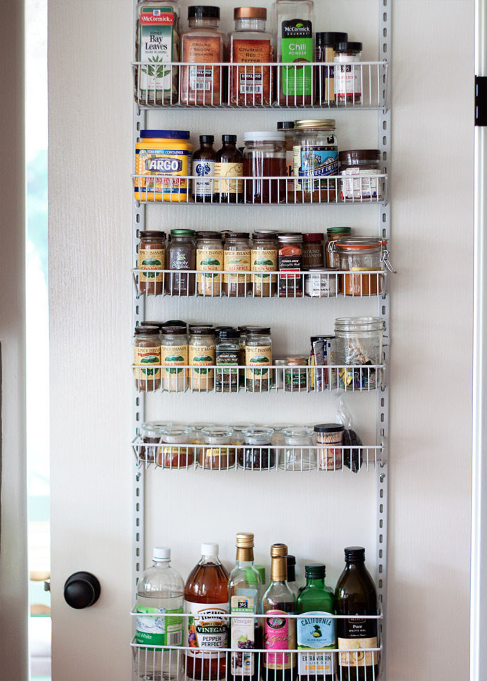 How We Organized Our Small Kitchen Pantry - This tiny pantry was whipped into shape with crisp white paint, some careful planning, lots of chalkboard labels, and more pantry organization ideas.