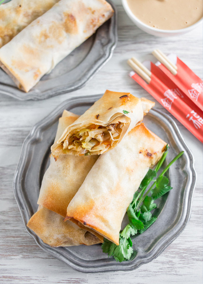 Crispy Baked Veggie Egg Rolls recipe - These veggie-packed egg rolls crisp up perfectly in the oven - no deep frying necessary. Just add chicken for the omnivores - easily made vegan too!