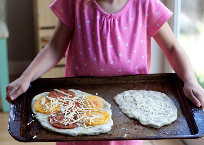 Individual Homemade Pizzas any which way you like - customize for vegans, vegetarians, and omnivores.