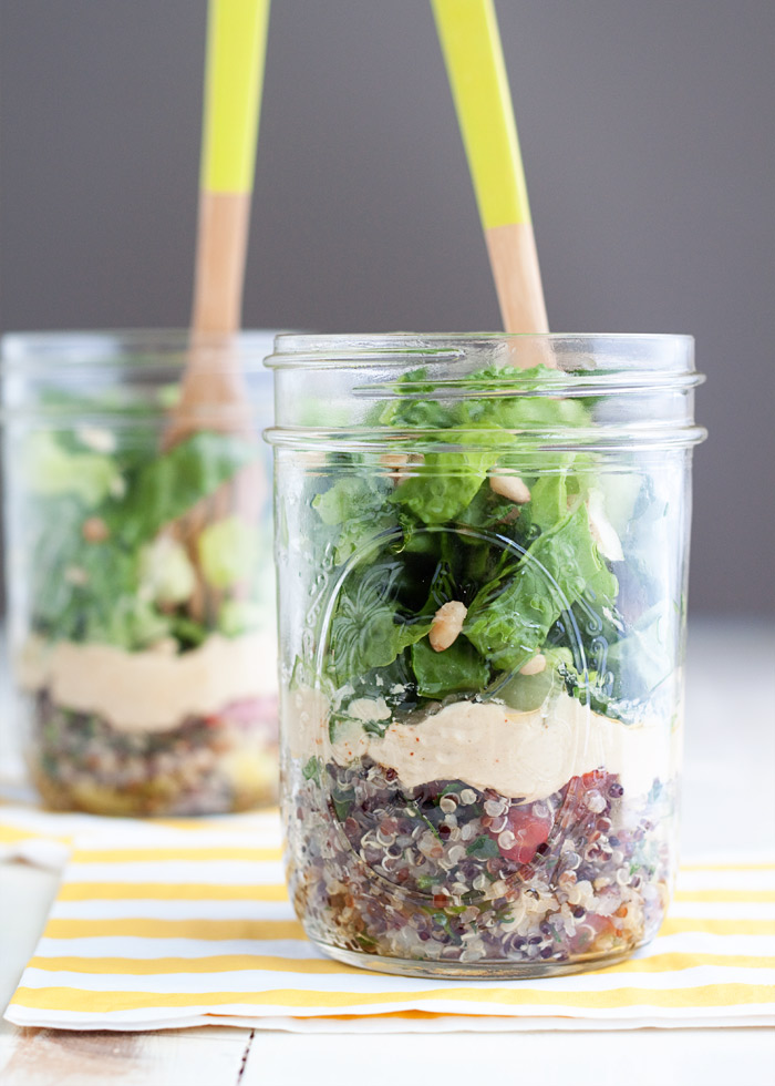 Tabbouleh Hummus Mason Jar Salads - Like a mini grain bowl on the move, these hearty, protein-packed mason jar salads are layered with tabbouleh, hummus, greens, and toasted pine nuts. So easy and, frankly, darn cute! Vegan with gluten-free option.
