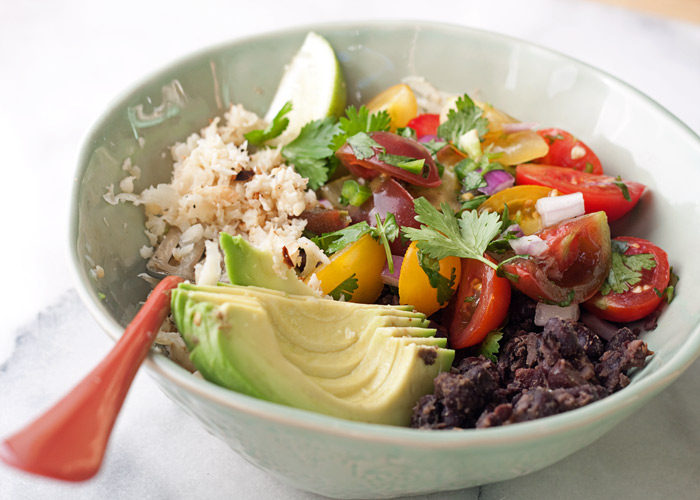 Cauliflower Rice Black Bean Burrito Bowl recipe - A base of cauliflower rice and seasoned black beans topped generously with cherry tomato pico de gallo and creamy avocado. Love this easy, healthy dinner! (vegan & gluten-free)