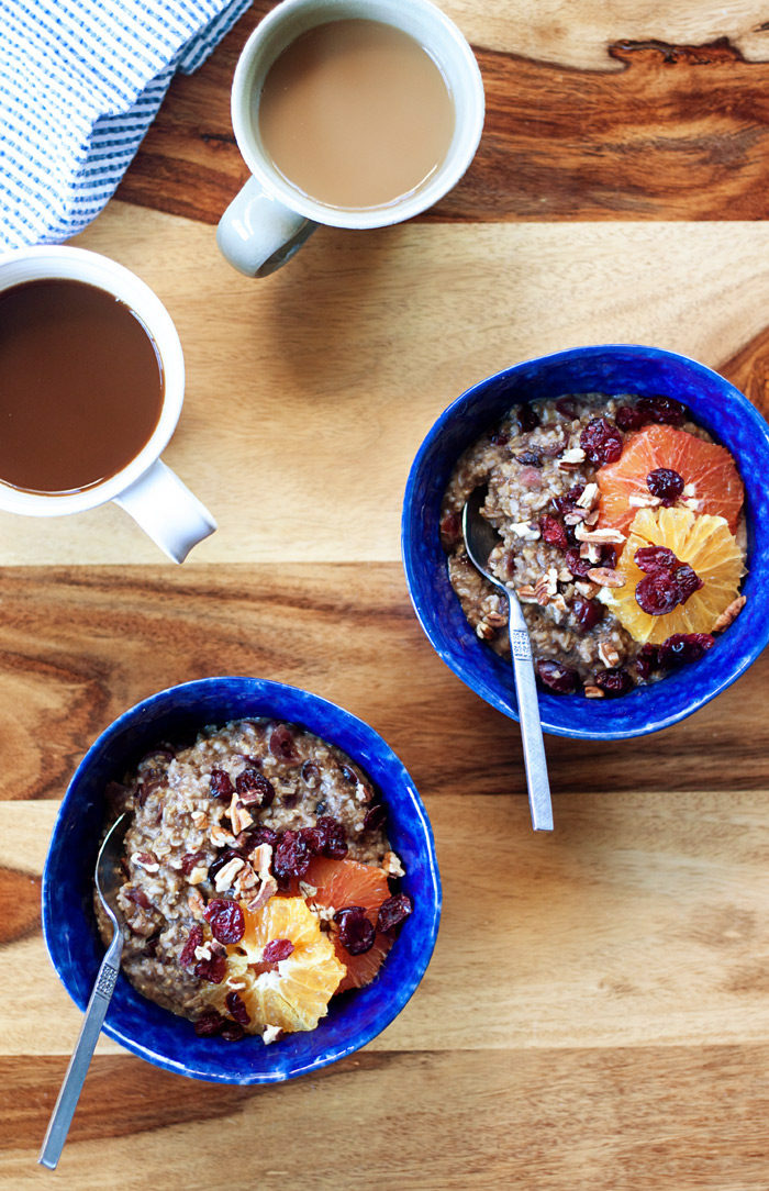 Orange Cranberry Steel-Cut Oatmeal recipe - Creamy, warmly spiced, and just different enough to be special, this hearty vegan oatmeal is full of cozy flavors - the perfect breakfast for when the weather turns colder.