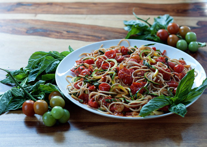 20 minutes and 6 ingredients! Zoodles & Noodles with Burst Cherry Tomato Sauce is a super-easy vegan dinner recipe that makes the most of last-of-season summer produce. But don't be fooled - this dish can be enjoyed any time of year. Grocery store cherry tomatoes usually the most flavorful, even in the heart of winter!