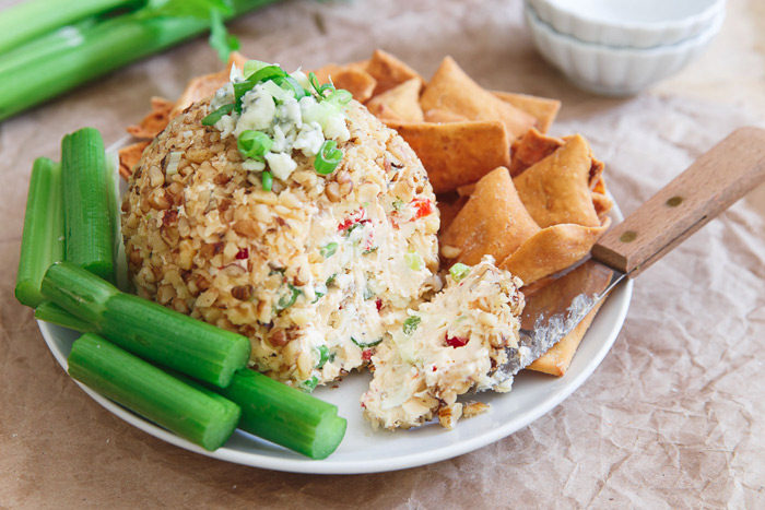 Buffalo Cheese Ball recipe - All the flavor of buffalo hot wings with none of the bird (or the work)! An easy appetizer made healthier with light cream cheese and veggies. Vegetarian.