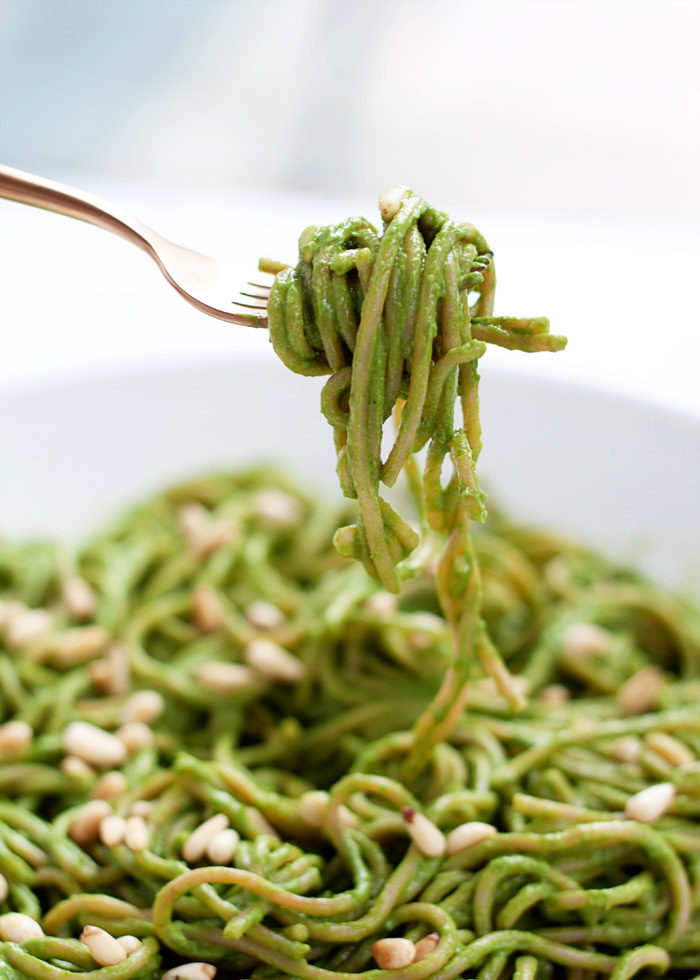 Creamy Avocado Kale Pesto Pasta - Only 20 minutes and a short list of ingredients and you have an entirely plant-based, utterly creamy, vibrantly green, and absolutely delicious pasta on your hands. And in your mouth. Vegan; meat option