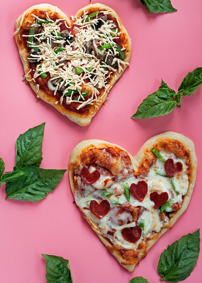 "How to Make Heart-Shaped Pizzas - Easy step-by-step tutorial with photos. Grab some dough, arm yourself with the ""pinch-and-pull"" technique, and go heart-shaped this Valentine's Day! Easily customized for meat-eaters, vegetarians, or vegans."