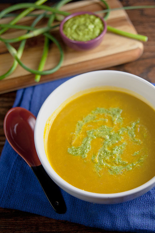9 Creative Carrot Soup Recipes! Here we have a Chilled Carrot Soup with Garlic Scape Pesto from @healthydelish. Perfect make-ahead soup to impress company with.