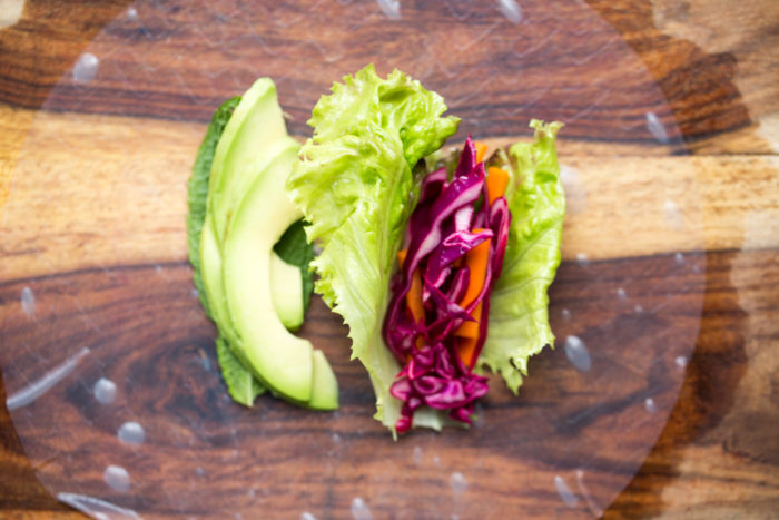Fresh Avocado Summer Rolls with Peanut Dipping Sauce - Fresh, veggie-packed rolls with avocado, red cabbage, carrots, basil, and mint - all served up with a super easy peanut dipping sauce. Perfect appetizer or light summer dinner!