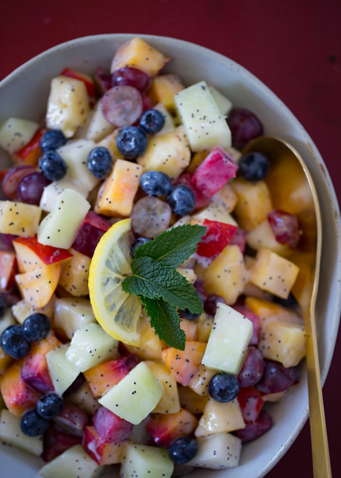 Summer Fruit Salad with Lemon Poppyseed Yogurt Dressing - This fresh and easy fruit salad features juicy summer fruits and a zingy, creamy, dairy-free yogurt dressing.