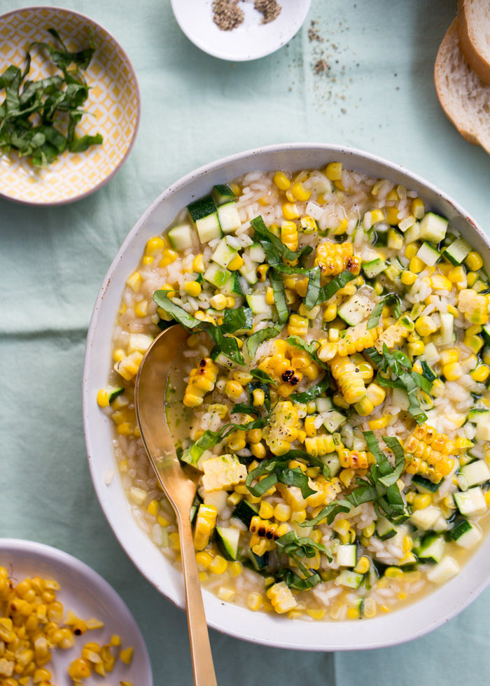 Sweet Corn & Zucchini Risotto - This one is alll about summer. Sweet corn right off the cob, fresh zucchini, and a gorgeous green basil oil to finish. A risotto that's worthy of a special occasion but also equally perfect for a simple one-pot weeknight dinner. Vegan & gluten-free.
