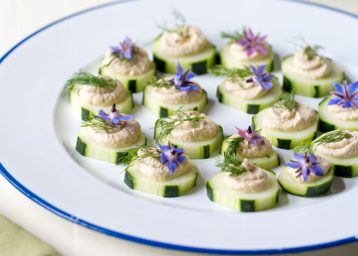 Cucumber Slices with Smoky Sunflower Seed Pate - A fresh, healthy, make-ahead appetizer made with a creamy sunflower seed and fresh dill pate. Garnish how you like depending on the season. Vegan & gluten-free.