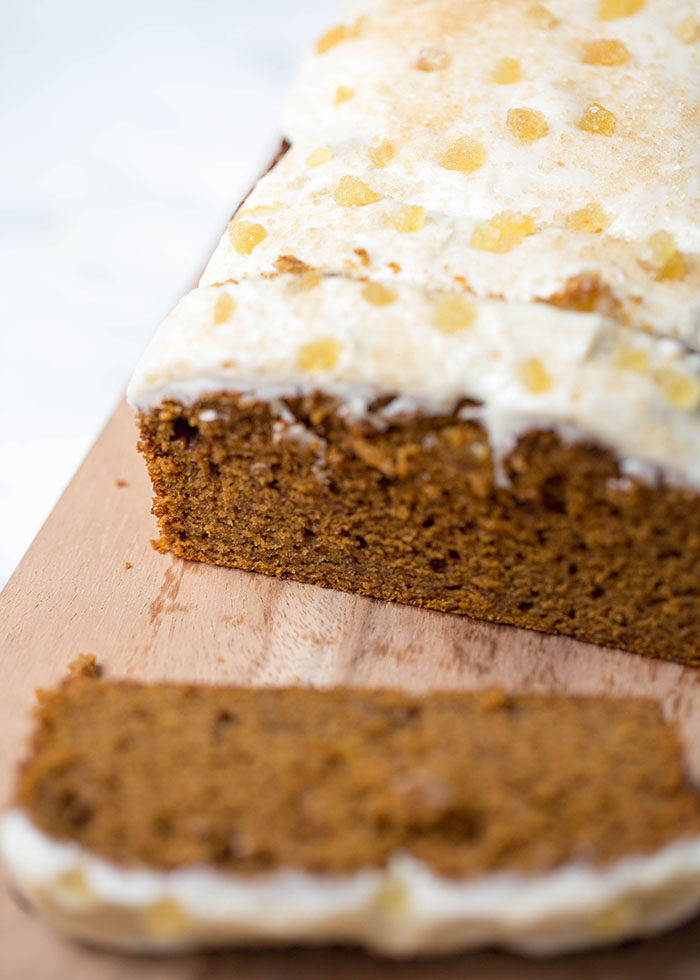 Spiced Pumpkin Gingerbread with Maple-Vanilla Icing recipe - This rich, splurge-worthy gingerbread is pimped out for fall, with pumpkin puree, fall spices, and a decadent layer of thick maple-vanilla icing smothered over the top. If you really want to go for it, be sure to add the coarse Demerara sugar and candied ginger as a final touch. Dairy-free.