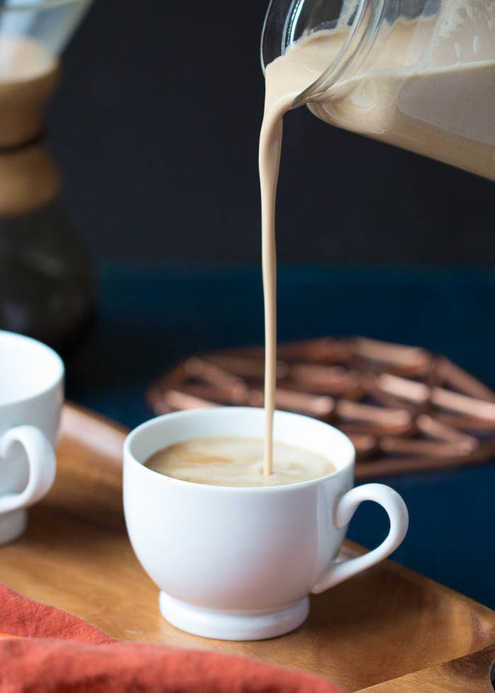 Rich and creamy vegan non-dairy pumpkin spice cashew coffee creamer! It's so simple - just cashews, pumpkin, spices, maple syrup, and water. Cozy up! #pumpkinspicecoffee