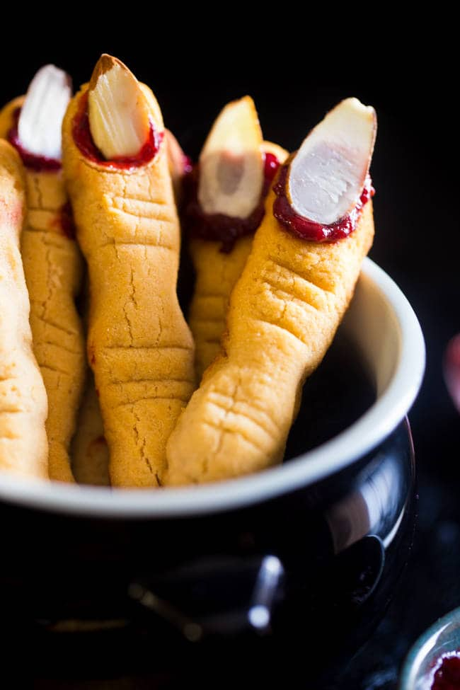 Come hither, my pretties! Here are 10 Witch Finger Snack Ideas - enough to count on both hands. Breadsticks, cookies, candy pretzels, and more including these Paleo Witch Finger Cookies from @foodfaithfit. #witchesfingers #halloweensnacks #halloween