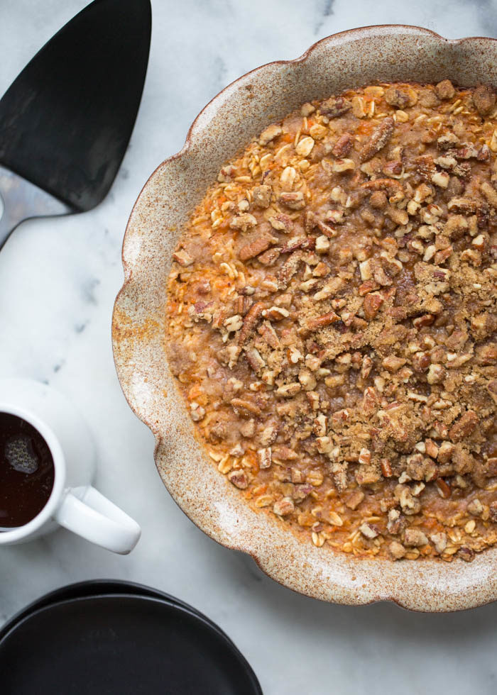 Sweet Potato Pie Baked Oatmeal with Crunchy Pecan Streusel - Cinnamon, nutmeg, and sweet potato meet baked oatmeal in this easy breakfast recipe. The crunchy pecan streusel totally seals the deal.