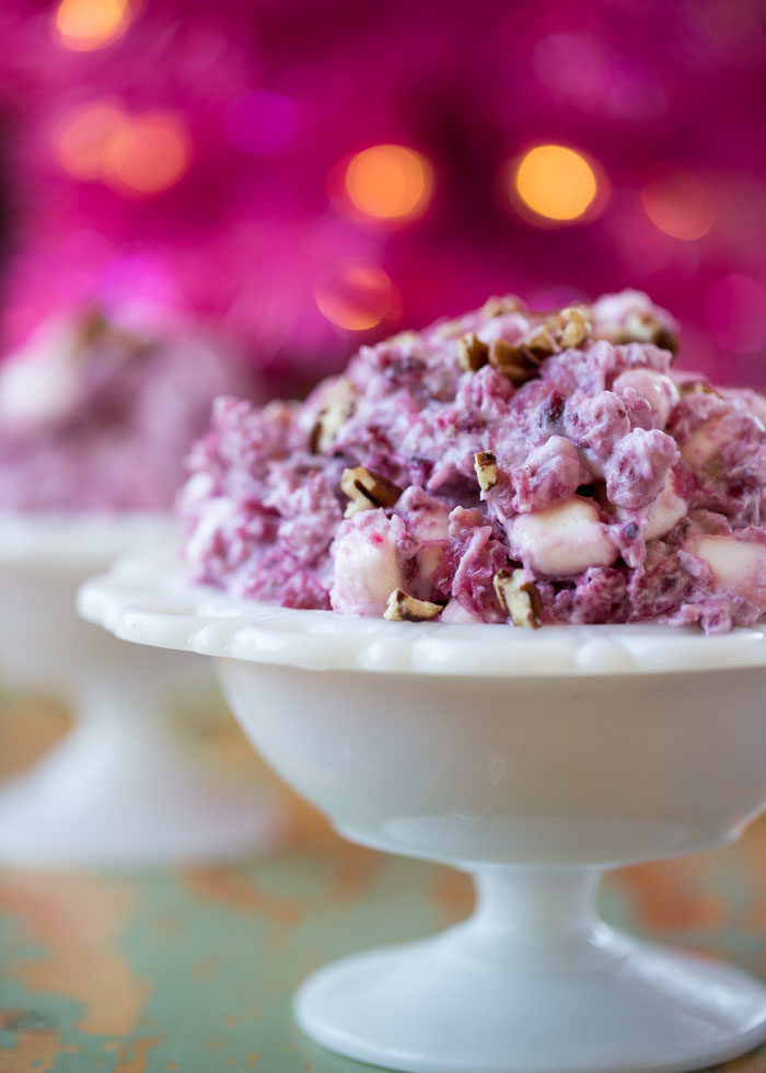 Creamy, dreamy cranberry fluff salad made vegan with coconut whipped cream and vegan-friendly mini marshmallows. Is it a salad? Is it a dessert? Does it matter? :) #veganchristmas #vegancranberrysalad #cranberrysalad