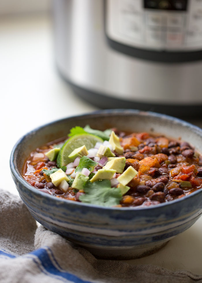 Simple Instant Pot Vegan Black Bean Chili - With less than 10 ingredients, this hearty chili comes together quickly and easily. It might be fast and simple, but thanks to the magic of pressure cooking, it tastes like it simmered all day. So, so good! #instantpotchili