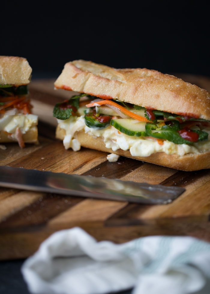 Egg Salad Banh Mi Sandwiches - Next-level egg salad! Piled high with quick-marinated veggies, fresh cilantro and mint, some jalapeños and Sriracha for heat; all on a crunchy-chewy-soft golden baguette. So good! #vegetarianbanhmi