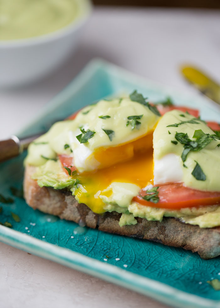 Avocado Toast Eggs Benedict with Avocado Hollandaise - The ultimate avocado lover's breakfast! A vegetarian eggs benedict that's super easy to make - this one hits all the marks.