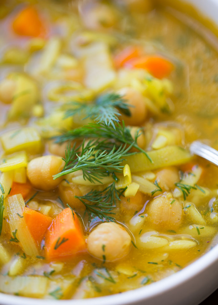 Chickpea Orzo Soup with Lemon & Dill - A hearty squeeze of lemon and loads of fresh dill liven up this chunky veggie-and-chickpea soup. #lemonorzosoup #vegansoup
