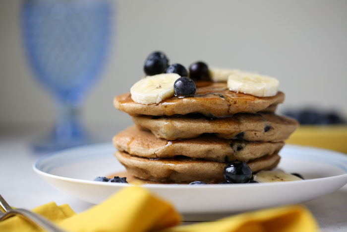 Blueberry Banana Oat Blender Pancakes - Gluten-free, vegan, made right in the blender for super-easy clean-up. #glutenfreepancakes #veganpancakes