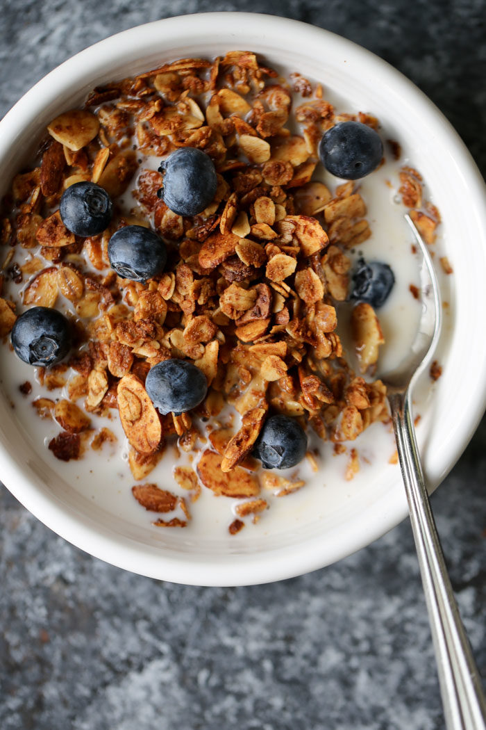 Crunchy-sweet, hearty, and super easy - this homemade cinnamon almond butter granola is a winner. Love it for easy snacks and quick breakfasts. #granolarecipe