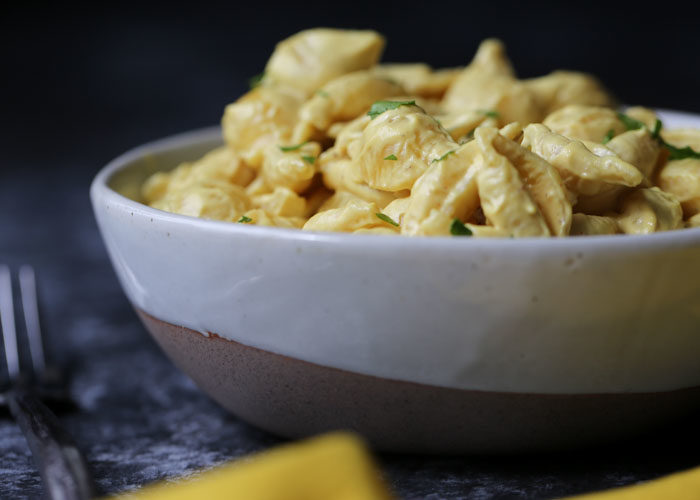 The ultimate vegan shells and cheese recipe. Fast, easy, and so tasty, it's even carnivore-approved. Reminiscent of the Velveeta classic, but SO much better! #veganmacandcheese