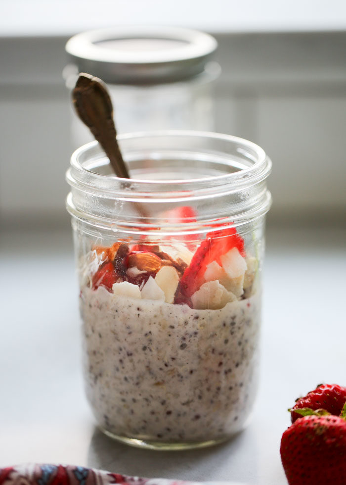 Overnight grains in a mason jar with a spoon in it