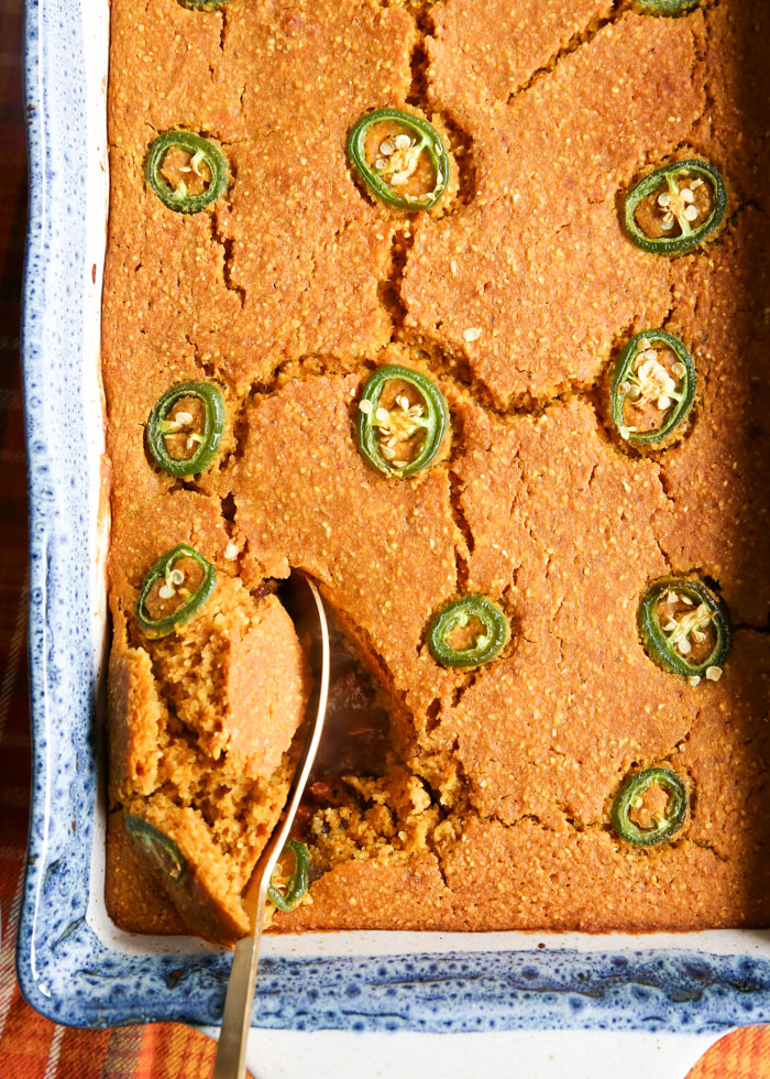 Pumpkin Chili Cornbread Bake - A favorite fall dinner, pumpkin chili, cooked up casserole style with a layer of glorious pumpkin cornbread baked right over the top. The perfect cornbread-to-chili ratio, right here!