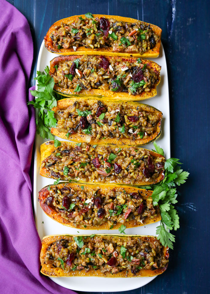 Wild Rice & Lentil Stuffed Delicata Squash with Cranberries & Pecans - Wild rice pilaf heartied up with lentils, flavored with curry spices and cumin, and dotted with sweet dried cranberries and crunchy pecans - all served up in delicious roasted delicata squash halves. Yum!