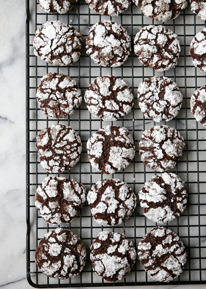 Vegan Chocolate Crinkle Cookies - Fudgy, sweet, and gorgeously crinkled just like their non-vegan twins, these chocolate cookies are perfect for Christmas cookie platters - or hoard them all for yourself. Not that I would ever do that.